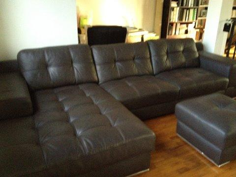 Top-grade German grain leather sofa set in flawless condition. L-shaped 3-seater with 1 ottoman. Hardly used as this was an extra set kept upstairs.